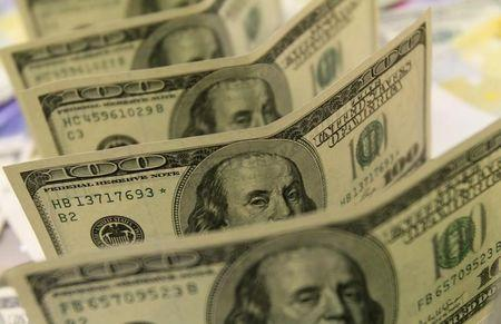 Dollar jumps to three-week high ahead of U.S