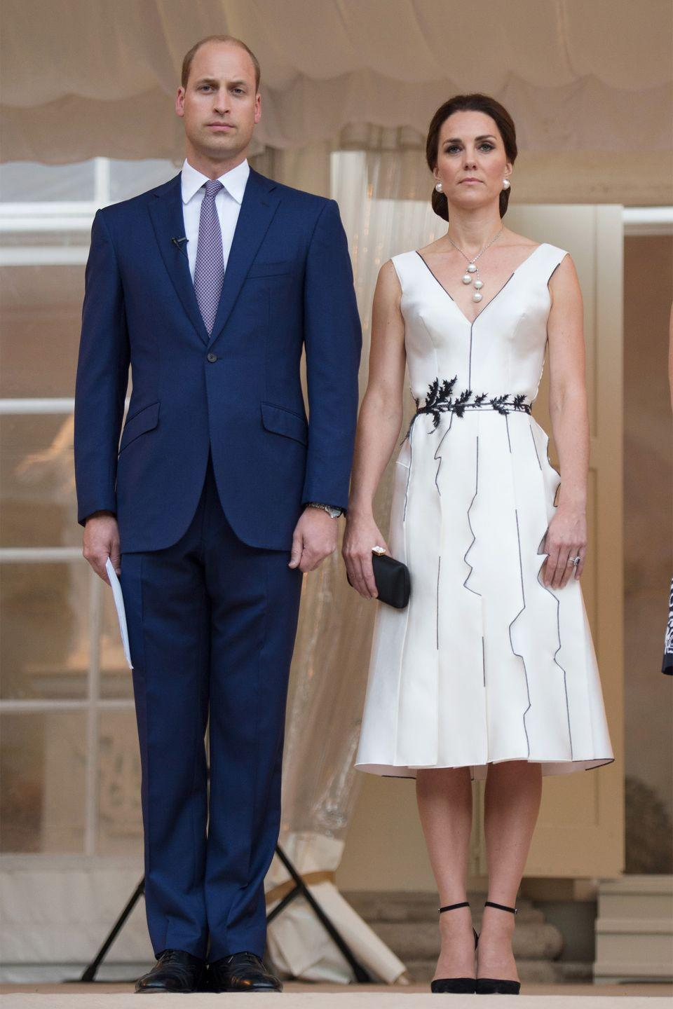 <p>In a custom dress by Gosia Baczynska, pearl necklace, matching earrings and Gianvito Rossi heels at a garden party celebrating The Queen in Warsaw, during the royal tour of Poland. </p>
