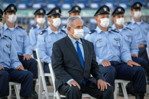 """Israeli Prime Minister Benjamin Netanyahu (C) broke the news of an impending collaboration between the Jewish state and the Arab Gulf country to fight the novel coronavirus, following """"prolonged and intense contacts"""""""
