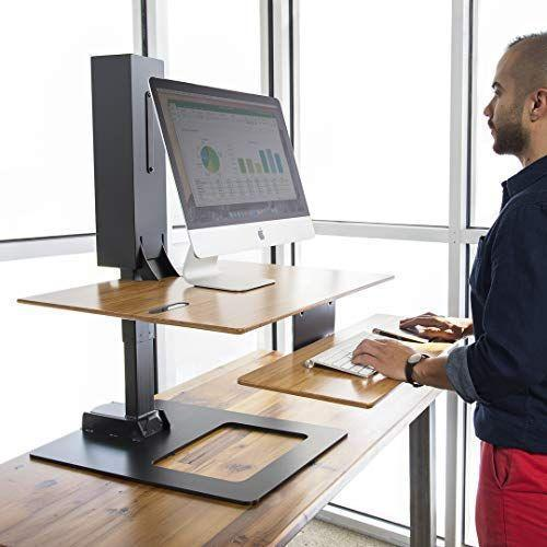 "<p><strong>UPLIFT Desk</strong></p><p>upliftdesk.com</p><p><strong>$439.00</strong></p><p><a href=""https://www.upliftdesk.com/e7-electric-standing-desk-converter/"" rel=""nofollow noopener"" target=""_blank"" data-ylk=""slk:Shop Now"" class=""link rapid-noclick-resp"">Shop Now</a></p><p>If you're in the model for a more compact, electronic desktop convertor, UPLIFT's E7 model is sold in a variety of sizes for multiple monitors — <strong>but all are based on a 21.5"" wide desktop that is more compact than other models.</strong> The E7 can hold up to 110 pounds of belongings, and is equipped to mount a computer monitor if you're interested in doing so. Rothman notes that this design becomes more compact if you tuck away the attached keyboard tray when not in use. </p>"
