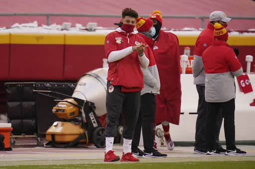 Kansas City Chiefs quarterback Patrick Mahomes watches from the sideline during the first half of an NFL football game against the Los Angeles Chargers, Sunday, Jan. 3, 2021, in Kansas City. (AP Photo/Jeff Roberson)