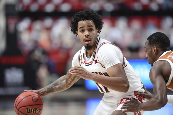 Texas Tech's Kyler Edwards (11) controls the ball during the first half of an NCAA college basketball game against Texas in Lubbock, Texas, Saturday, Feb. 27, 2021. (AP Photo/Justin Rex)
