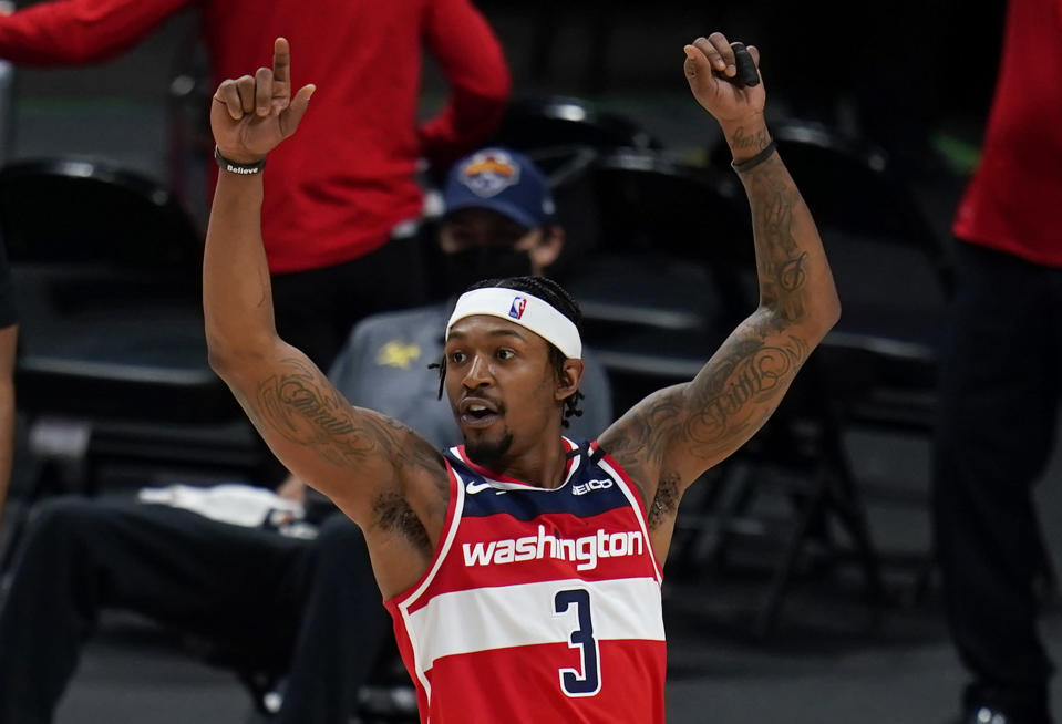 Washington Wizards guard Bradley Beal celebrates the team's win over the Denver Nuggets in an NBA basketball game Thursday, Feb. 25, 2021, in Denver. (AP Photo/Jack Dempsey)