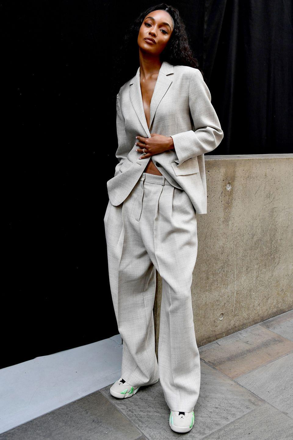 <p><strong>21 September</strong></p><p>Model Jourdan Dunn posed in a chic beige suit outside the Cos show at London Fashion Week. </p>