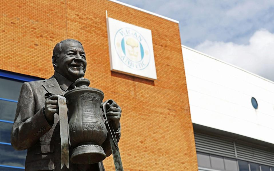 A general view of the Dave Whelan statue outside the DW Stadium, home to Wigan Athletic  - PA