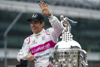 FILE - Helio Castroneves, of Brazil, winner of the 2021 Indianapolis 500 auto race, poses during the traditional winners photo session at the Indianapolis Motor Speedway in Indianapolis, in this Monday, May 31, 2021, file photo. Superstar Racing Experience was conceptualized as a series for former greats who still had the skills and desire to compete and square off in identically prepared cars at six of America's classic short tracks. Castroneves has no full-time job this season so joining SRX was a no-brainer. (AP Photo/Michael Conroy, File)