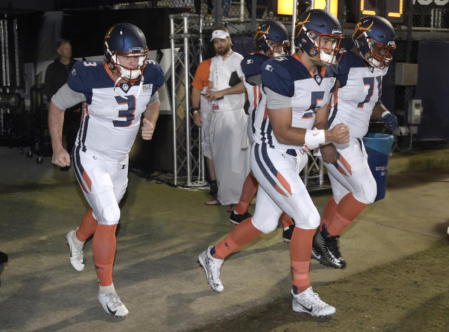 "Orlando Apollos quarterback <a class=""link rapid-noclick-resp"" href=""/nfl/players/27742/"" data-ylk=""slk:Garrett Gilbert"">Garrett Gilbert</a> (3), quarterback Austin Appleby (5) and offensive lineman Ronald Patrick (71) run on the field before an AAF game. (AP)"