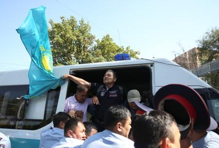 Law enforcement officers detain opposition supporters during a rally in Almaty