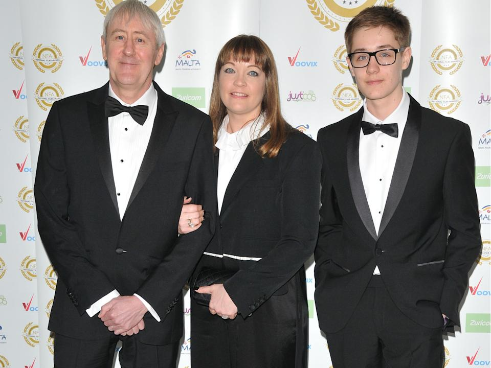 <p>Archie (far right) with his father Nicholas Lyndhurst and mother Lucy Smith in 2017</p> (Rex Features)