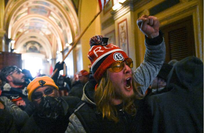 Supporters of President Donald Trump protest inside the U.S. Capitol on January 6, 2021.  Demonstrators breeched security and entered the Capitol as Congress debated the a 2020 presidential election Electoral Vote Certification. (Roberto Schmidt/AFP via Getty Images)