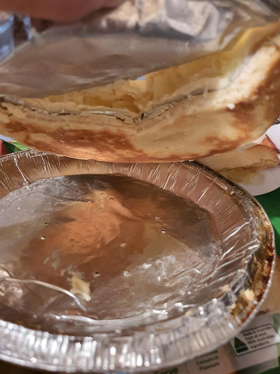 A layer of aluminium foil squished into the pie.