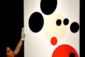 File photo dated 7/2/2014 of an employee hangs the Damien Hirst inspired Mickey Mouse which is to be auctioned tonight in the 'Post war and contemporary art evening auction' to be held at Christie's in central London. PRESS ASSOCIATION Photo. Issue date: Thursday February 13, 2014. See PA story SALE Mickey. Photo credit should read: John Stillwell/PA Wire