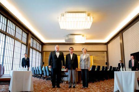 U.S. Secretary of State Mike Pompeo, Japan's Foreign Minister Taro Kono and South Korea's Foreign Minister Kang Kyung Wha pose for members of the media as they meet in Tokyo, Japan, July 8, 2018. Andrew Harnik/Pool via Reuters