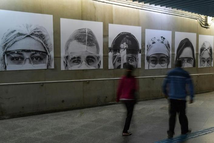 Pictures of medical workers taken by Brazilian photographer Thiago Santos at posted in a Sao Paulo subway station amid the COVID-19 pandemic (AFP Photo/NELSON ALMEIDA)