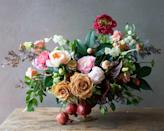 "<p>For a bountiful appearance, add branches of pomegranates to the bottom of your centerpiece arrangement, and echo their hue in an accent bloom. This arrangement also incorporates neutral-toned flowers to anchor the many colors present in the centerpiece. </p><p><em>Via <a href=""http://tulipina.com/"" rel=""nofollow noopener"" target=""_blank"" data-ylk=""slk:Tulipina"" class=""link rapid-noclick-resp"">Tulipina</a></em></p>"
