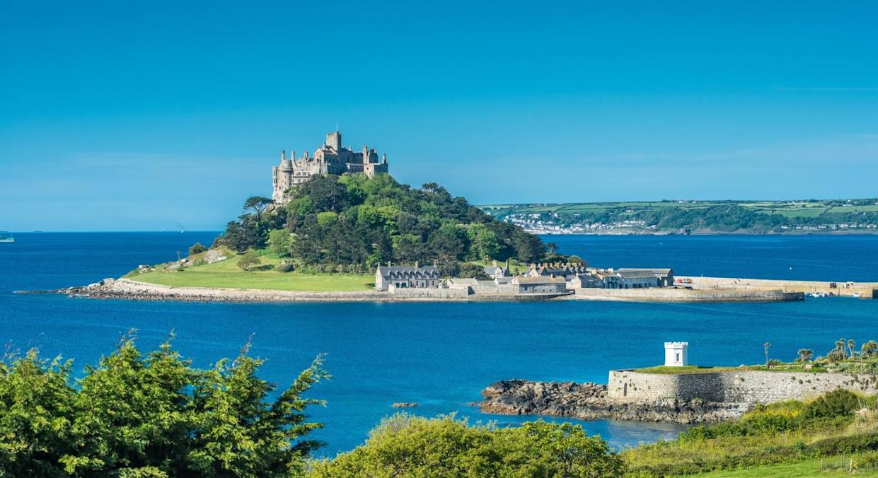St Michael's Mount sits off the coast of Cornwall (Getty)