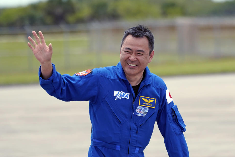 SpaceX Crew 2 member Japan Aerospace Exploration Agency astronaut Akihiko Hoshide waves after a news conference at the Kennedy Space Center in Cape Canaveral, Fla., Friday, April 16, 2021 as he prepares for a mission to the International Space Station. The launch is targeted for April 22. (AP Photo/John Raoux)