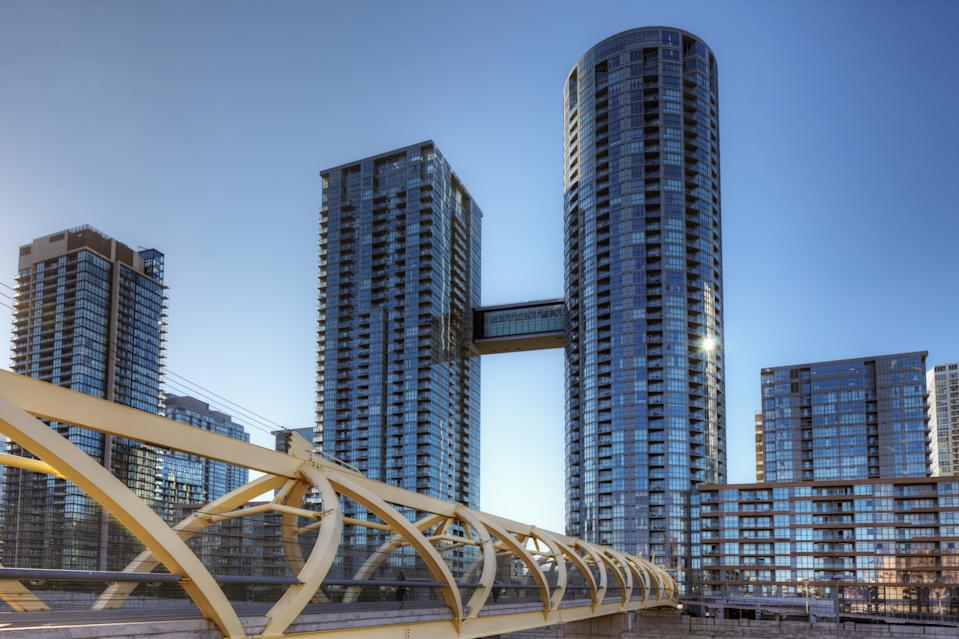 Toronto, Canada - August 22, 2015: Toronto's CityPlace condominiums near Lake Ontario. CityPlace is a large residential development on land formerly owned by the railway. Shown are the buildings Parade )ne and Parade Two which have been connected by a sky bridge.