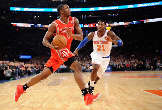 NEW YORK, NY - NOVEMBER 14: Terrence Jones #6 of the Houston Rockets drives past Iman Shumpert #21 of the New York Knicks during the first quarter at Madison Square Garden on November 14, 2013 in New York City. NOTE TO USER: User expressly acknowledges and agrees that, by downloading and/or using this photograph, user is consenting to the terms and conditions of the Getty Images License Agreement. (Photo by Maddie Meyer/Getty Images)