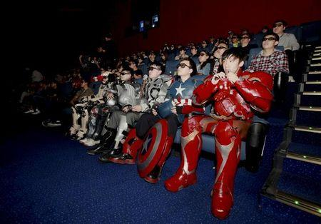 "FILE PHOTO - Fans dressed in replic armour of the main characters in ""Avengers: Age of Ultron"" watch the movie in a theatre in Changchun"