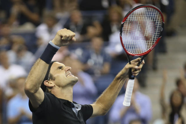 Roger Federer, of Switzerland, celebrates after defeating Gael Monfils, of France, 4-6, 3-6, 6-4, 7-5, 6-2 during the quarterfinals of the U.S. Open tennis tournament, Thursday, Sept. 4, 2014, in New York. (AP Photo/John Minchillo)