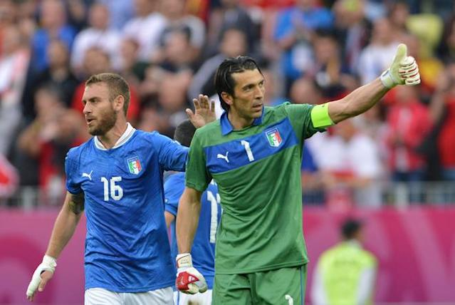 Italian midfielder Daniele De Rossi (L) and Italian goalkeeper Gianluigi Buffon react at the end of the Euro 2012 championships football match Spain vs Italy on June 10, 2012 at the Gdansk Arena. AFP PHOTO/ GIUSEPPE CACACEGIUSEPPE CACACE/AFP/GettyImages
