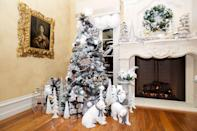 <p>This well-crafted tree boasts opulent holiday glam with young and quirky accents. The decor is a maximalist's dream, while the frosty white palette refines the space. Decorative pieces surround the presents for extra pizzazz. </p>