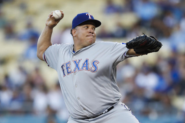 Texas Rangers starting pitcher Bartolo Colon throws to a Los Angeles Dodgers batter during the first inning of a baseball game Tuesday, June 12, 2018, in Los Angeles. (AP Photo/Jae C. Hong)