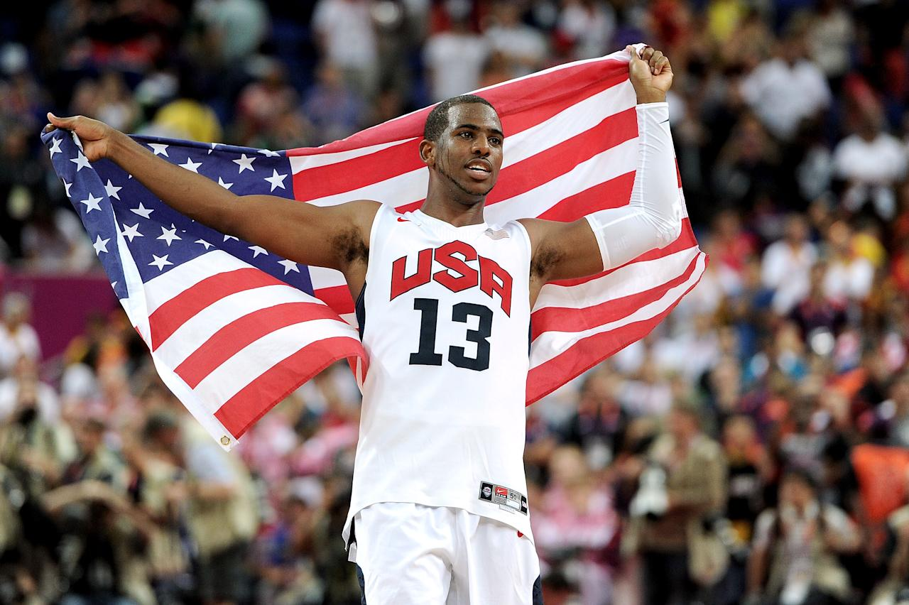 LONDON, ENGLAND - AUGUST 12:  Chris Paul #13 of the United States celebrates winning the Men's Basketball gold medal game between the United States and Spain on Day 16 of the London 2012 Olympics Games at North Greenwich Arena on August 12, 2012 in London, England.  (Photo by Harry How/Getty Images)