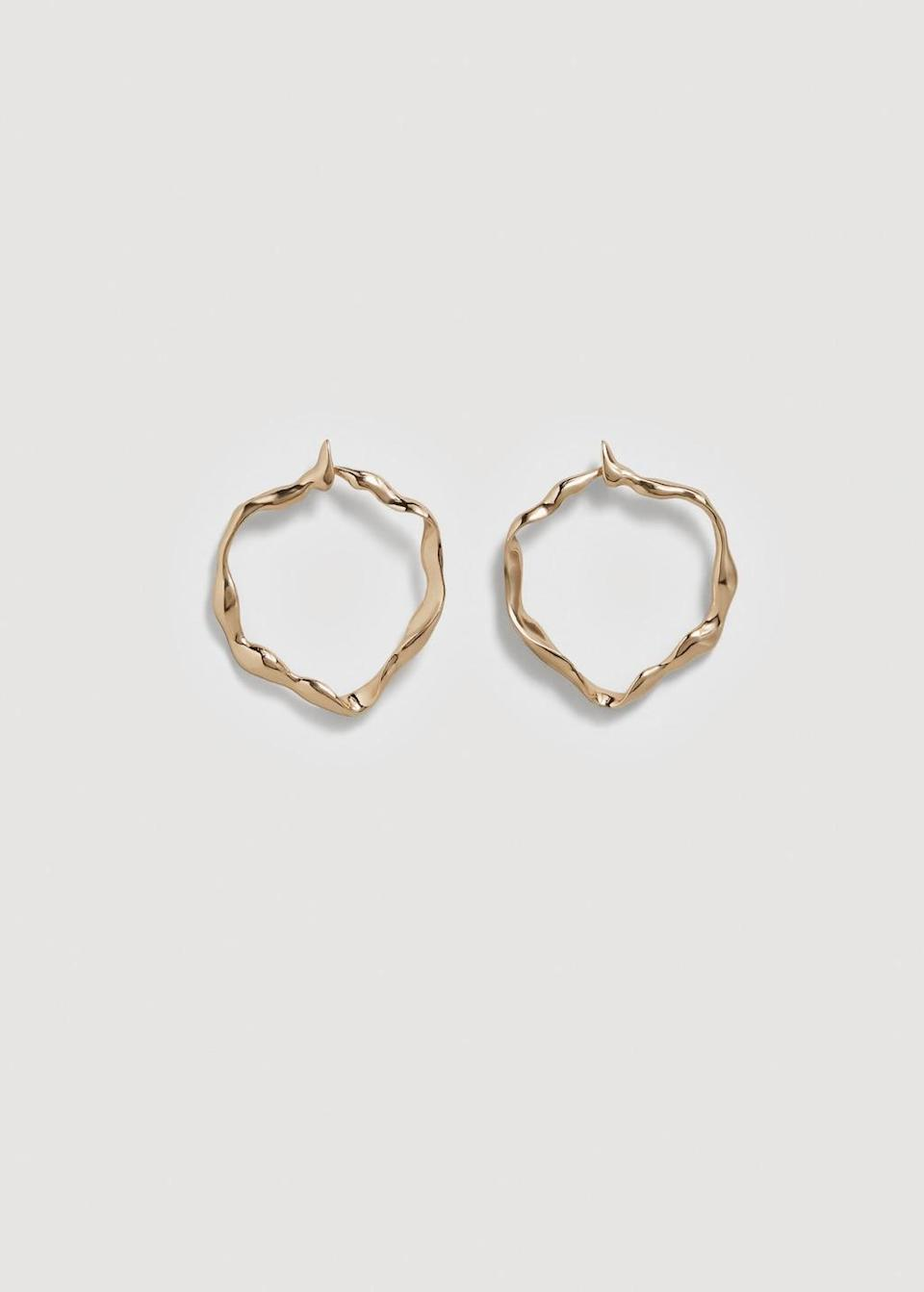 """<p>Mango never let us down when it comes to affordable jewellery that actually looks expensive, and these beat-up looking hoops tick all the right boxes. <em><a rel=""""nofollow noopener"""" href=""""https://shop.mango.com/gb/women/jewellery-earrings/embossed-hoop-earrings_23040447.html?c=OR&n=1&s=accesorios.accesorio;48,448"""" target=""""_blank"""" data-ylk=""""slk:Buy here."""" class=""""link rapid-noclick-resp"""">Buy here.</a></em> </p>"""
