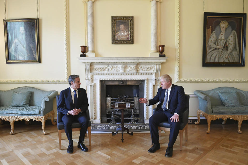 Britain's Prime Minister Boris Johnson, right, and US Secretary of State Antony Blinken inside 10 Downing Street in London, Tuesday, May 4, 2021. Foreign ministers from the Group of Seven wealthy industrialized nations gathered in London to grapple with threats to health, prosperity and democracy. It is their first face-to-face meeting in more than two years. (Stefan Rousseau/Pool via AP)