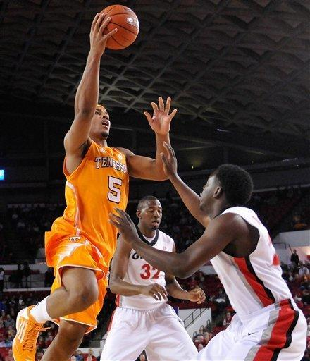 Tennessee forward Jarnell Stokes (5) shoots over Georgia guard Sherrard Brantley (23) during the first half of an NCAA college basketball game in Athens, Ga., Saturday, March 2, 2013. (AP Photo/The Athens Banner-Herald, AJ Reynolds)