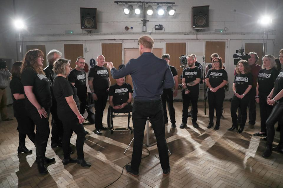 The Duke of Sussex meets members of the Invictus Games Choir during his visit Abbey Road Studios in London. PA Photo. Picture date: Friday February 28, 2020. They are recording a special single in aid of the Invictus Games Foundation. See PA story ROYAL Sussex. Photo credit should read: Hannah McKay/PA Wire
