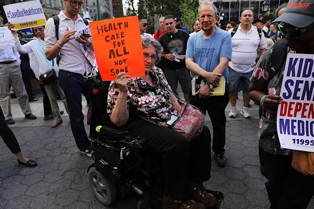 <p>Jean Ryan from Disabled in Action joins others in protesting against the Senate healthcare bill on June 28, 2017 in New York City. (Photo: Spencer Platt/Getty Images) </p>