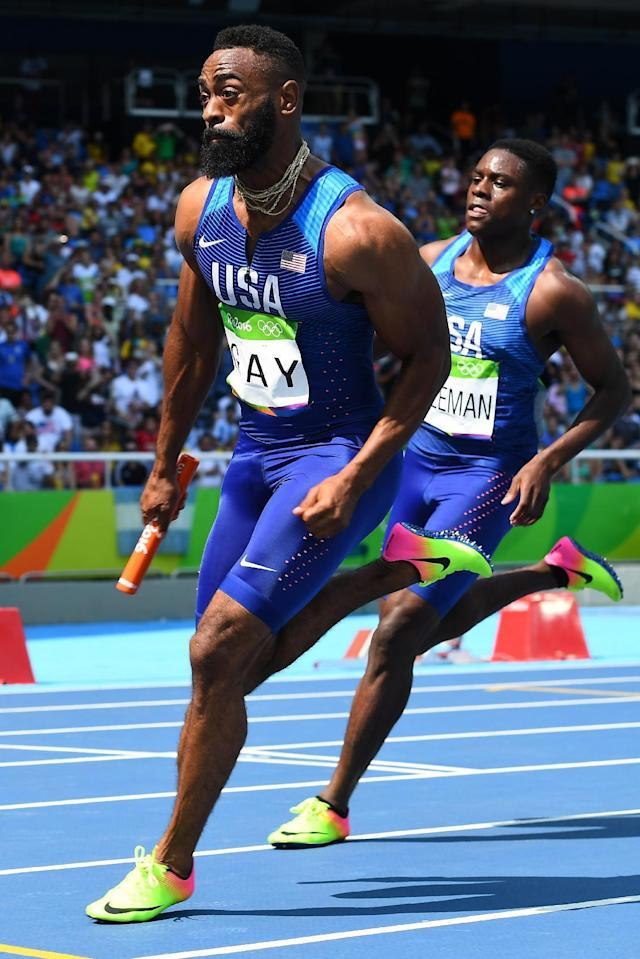 USA's Tyson Gay runs with the baton competes in the Men's 4 x 100m Relay Round 1 during the athletics event at the Rio 2016 Olympic Games at the Olympic Stadium in Rio de Janeiro on August 18, 2016. (AFP Photo/FRANCK FIFE)