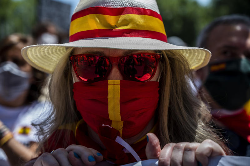 MADRID, SPAIN - 2020/06/27: A woman with a protective face mask with the Spanish flag during a protest to demand the resignation of Prime Minister Pedro Sanchez and to protest against the government's management of the health crisis due to the coronavirus (COVID-19) outbreak. (Photo by Marcos del Mazo/LightRocket via Getty Images)