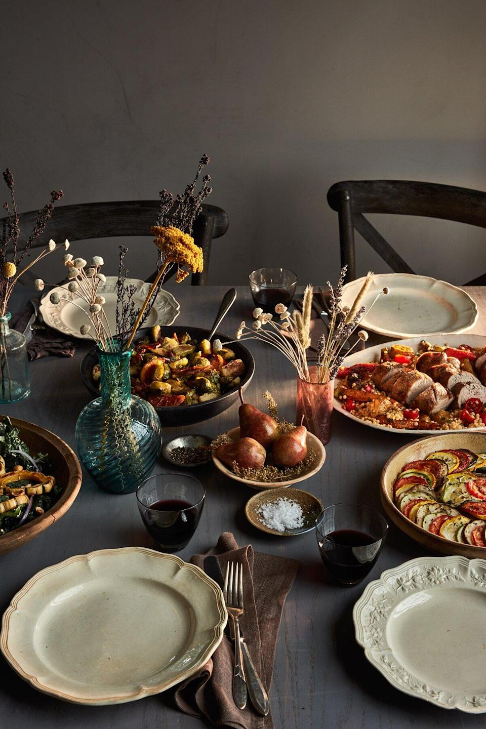 fall potluck table setting with food ready for serving