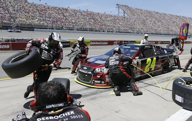 Jeff Gordon makes a pit stop during the NASCAR Quicken Loans 400 auto race at Michigan International Speedway in Brooklyn, Mich., Sunday, June 15, 2014. (AP Photo/Carlos Osorio)