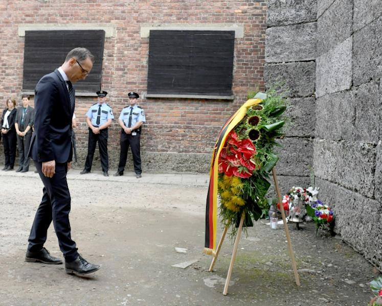German Foreign Minister Heiko Maas, seen here laying a wreath on Monday, has often said the death camp inspired him to go into politics