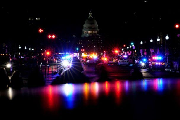 PHOTO: Lights from police vehicles illuminate Pennsylvania Avenue with the U.S. Capitol building in the background in Washington, D.C., on Jan. 6, 20201. (Carolyn Kaster/AP)