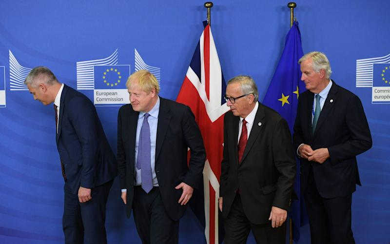 Brexit Secretary Stephen Barclay, Prime Minister Boris Johnson, Jean-Claude Juncker, President of the European Commission, and Michel Barnier, the EU's Chief Brexit Negotiator, ahead of the opening sessions of the European Council summit at EU headquarters in Brussels. PA Photo. Picture date: Thursday October 17, 2019. See PA story POLITICS Brexit. Photo credit should read: Stefan Rousseau/PA Wire Image title: POLITICS Brexit 14122619 - Stefan Rousseau/PA