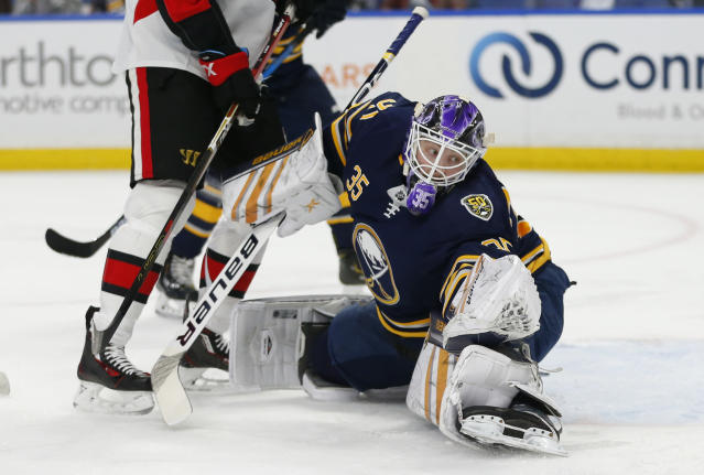 Buffalo Sabres goalie Linus Ullmark (35) makes a save during the first period of the team's NHL hockey game against the Ottawa Senators, Saturday, Nov. 16, 2019, in Buffalo, N.Y. (AP Photo/Jeffrey T. Barnes)