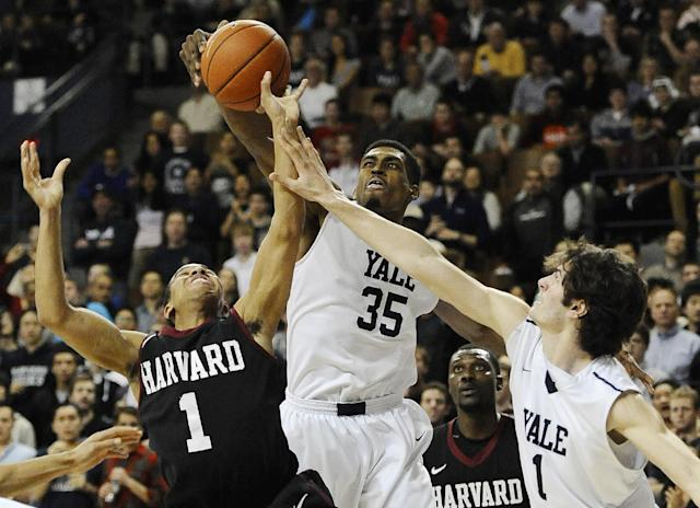 Yale's Brandon Sherrod, center, fouls Harvard's Siyani Chambers, left, as Yale's Anthony Dallier, right, defends during the second half of an NCAA college basketball game, Friday, March 7, 2014, in New Haven, Conn. Harvard won 70-58. (AP Photo/Jessica Hill)