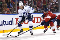 Tampa Bay Lightning center Steven Stamkos (91) skates with the puck as Florida Panthers defenseman Anton Stralman (6) gives chase during the first period in Game 5 of an NHL hockey Stanley Cup first-round playoff series, Monday, May 24, 2021, in Sunrise, Fla. (AP Photo/Lynne Sladky)