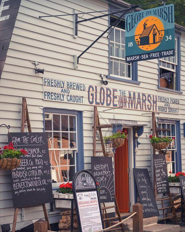 """<p>Now that your mouth's watering, let's think about where to eat. For coffee and cake in a stylish setting, try the immaculate The Fig, with bare bulbs, tasty brunch and delicious coffee.</p><p>If seafood by the sea is your bag, book a table at the 'sheep-shack chic' Globe Inn Marsh for generous portions of prawns, smoked mackerel, and fresh mussels. Or how about Rye Bay scallops at The George, or a classic fish and chips at Marino's? </p><p>It's famous among Rye's residents for a reason. For an afternoon out, take the car to Dungeness and visit the Fish Hut's Snack Shack for a crab flatbread. </p><p>Don't forget the pretty <a href=""""https://www.redescapes.com/offers/east-sussex-rye-mermaid-inn-hotel"""" rel=""""nofollow noopener"""" target=""""_blank"""" data-ylk=""""slk:Mermaid Inn"""" class=""""link rapid-noclick-resp"""">Mermaid Inn</a> for dining at an AA-Rosette restaurant and sipping wine from nearby wineries.</p><p><a href=""""https://www.instagram.com/p/CMW-gw4Bjgj/"""" rel=""""nofollow noopener"""" target=""""_blank"""" data-ylk=""""slk:See the original post on Instagram"""" class=""""link rapid-noclick-resp"""">See the original post on Instagram</a></p>"""