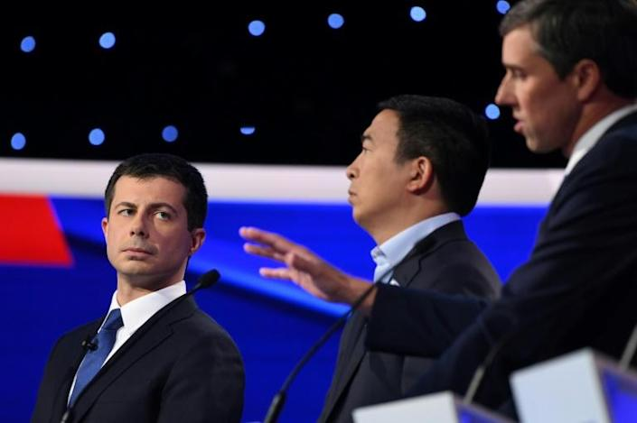 Democratic presidential hopeful Pete Buttigieg, the mayor of South Bend, Indiana (L) entrepreneur Andrew Yang (C) and ex-congressman Beto O'Rourke at the fourth Democratic primary debate of the 2020 presidential race (AFP Photo/SAUL LOEB)