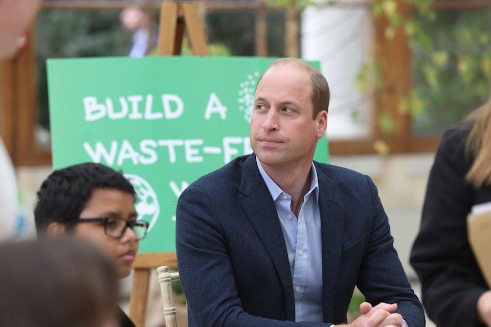 The Duke of Cambridge alongside children from The Heathlands School during a visit to the Royal Botanic Gardens in Kew (PA)