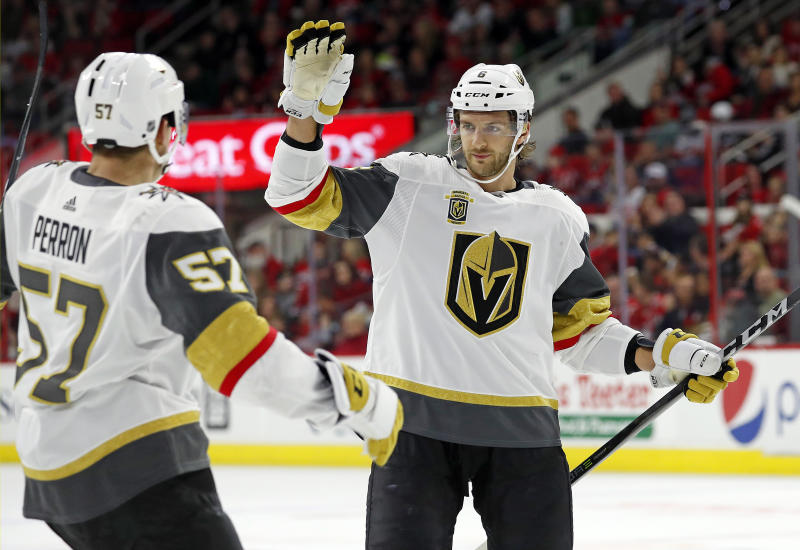 Golden Knights' Colin Miller (6) celebrates his goal against the Carolina Hurricanes with teammate David Perron (57) during the first period of an NHL hockey game, Sunday, Jan. 21, 2018, in Raleigh, N.C. (AP Photo/Karl B DeBlaker)