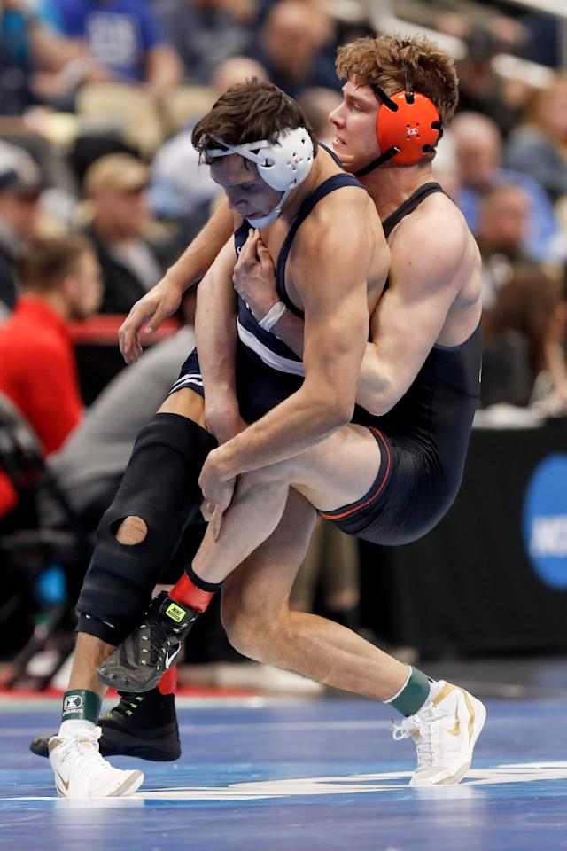 Princeton's Kevin Parker, right, and Penn State's Shakur Raseed battle during their 184 lbs. match in the first round of the NCAA college wrestling championship, Thursday, March 21, 2019, in Pittsburgh. (AP Photo/Keith Srakocic)