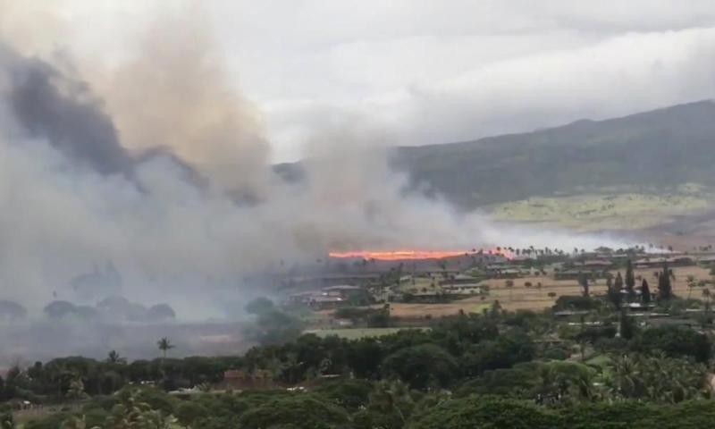 Smoke rises as a wildfire spreads in Kaanapali, Maui, Hawaii, in an image from social media video.